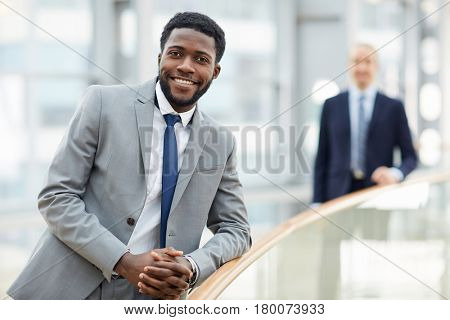 Attractive man in formalwear looking at camer with smile