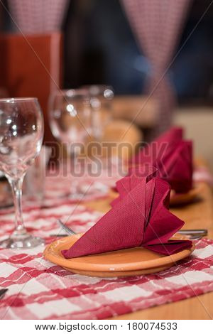 Glasses Napkin And Silver Utensils On The Tavern Table