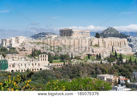 Famous skyline of Athens with Acropolis hill, Pathenon, Herodes Atticus amphitheater and Lycabettus Hill, Athens Greece