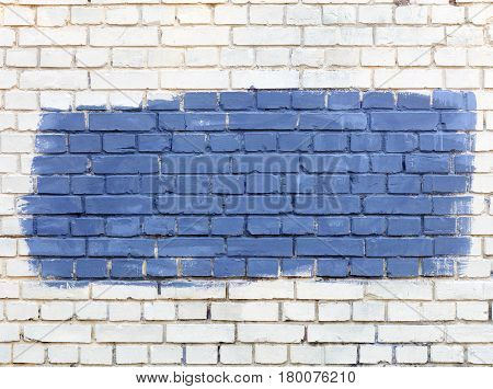 The old walls are painted with white paint and the selected fragment is painted with blue paint.