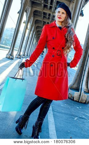 Tourist Woman On Pont De Bir-hakeim Bridge With Shopping Bag