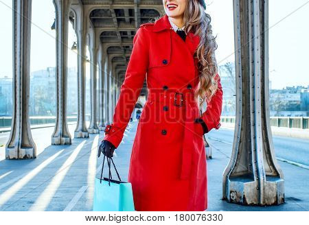 Tourist Woman With Shopping Bag In Paris Looking Into Distance