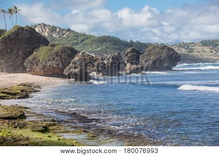Volcanic boulders in the ocean at Bathsheba on the East Coast of the Island of Barbados in the Caribbean Sea