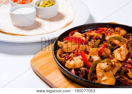 Stir Fry Chicken With Sweet Peppers And Green Beans In Wok Pan