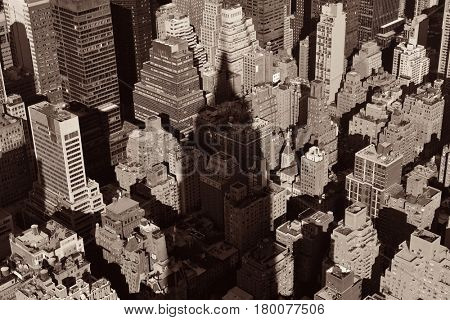 New York City - SEP 11: Empire State Building shadow over urban buildings on September 11, 2015 in New York City. With 8.5M, it is the is the most populous city in the United States.