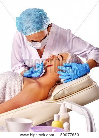 Filler injection for female forehead face. Plastic aesthetic facial surgery in beauty clinic. Beauty woman giving injections. Doctor in medical gloves with syringe injects cheeks drug