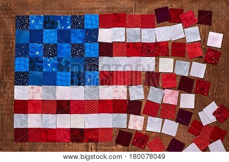 Square pieces of fabrics lying like a flag of USA