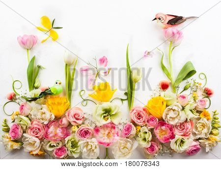 Festive flower composition on the white  background with copy space. Overhead view.