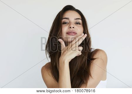 Young Beautiful brunette with atitude posing to camera