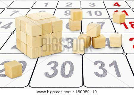 wooden cubes forming a bigger cube on calendar abstract creativity concept