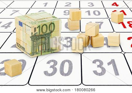 wooden cubes forming a bigger cube with euro banknote imprint