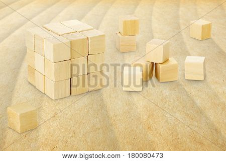 wooden cubes forming a bigger cube on wavy surface abstract creativity concept