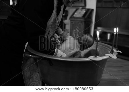 A ceremony of epiphany baby in church. Black and white photo.