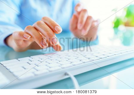 Hands or woman office worker typing on the keyboard