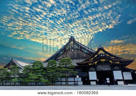 Clouds and light golden dawn with Ninomaru Palace of Nijo-jo Castle Kyoto Japan