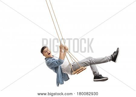 Joyful teenager swinging on a swing and looking at the camera isolated on white background