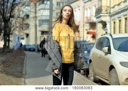 Girl Is Standing On The Sidewalk Near Parked Cars