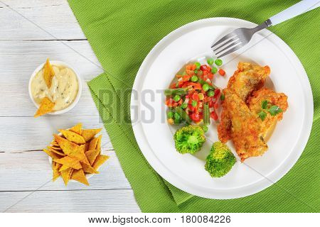 Fried Fish Fillets And Steam Cooked Vegetables