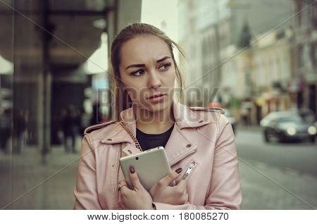 Sad Girl Walks Along The Sidewalk In The City
