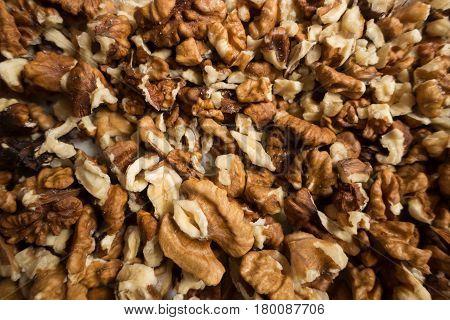 Lots of brown walnut kernels (peeled nuts)
