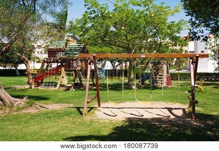 Children's Playground with swings and Playhouse in the street