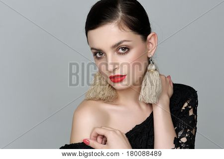 Girl With Self-made Earrings Of Threads, Who Bare Her Shoulder