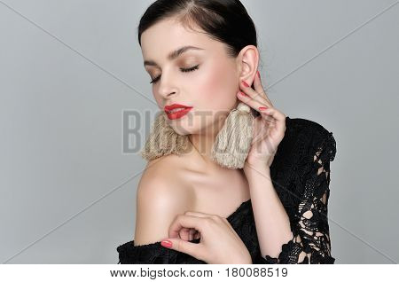 Girl Closed Her Eyes With Pleasure As She Touched Her Homemade Earrings