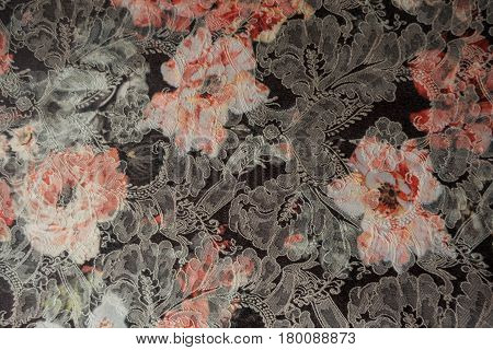 Close-up of jacquard fabric with floral print from above