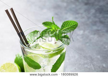 Mojito cocktail on dark stone table