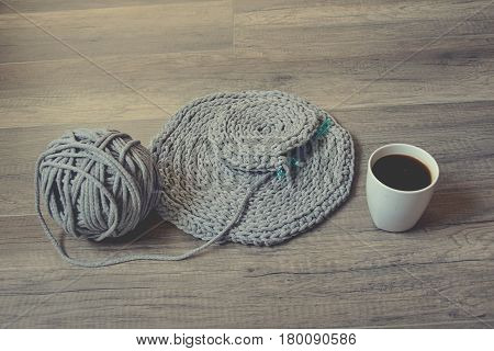 grey handmade cotto ncord tablecloths on crochet hook with coffee