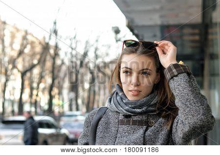 Вeautiful Woman Is Walking Down The Street In The City