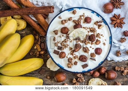 Serving of White Yogurt with Muesli Banana and Nuts