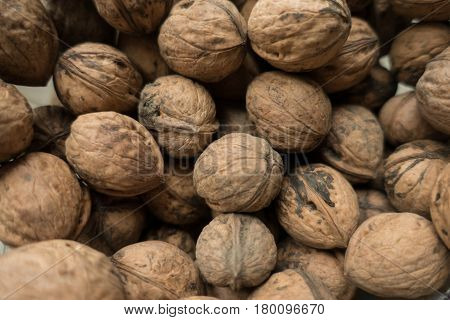 Whole unpeeled dry organic walnuts from above