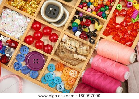 set of accessories and jewelry to embroidery, haberdashery, sewing accessories top view, seamstress workplace, many object for needlework, handmade and handicraft poster