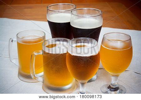 Six beer glasses on table. Selective focus