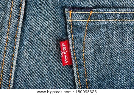 BANGKOK THAILAND - DECEMBER 09 2014: Close up of the LEVI'S red label on the back pocket of denim jeans. LEVI'S is a brand name of Levi Strauss and Co founded in 1853.