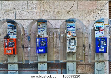 JERUSALEM, ISRAEL - DECEMBER 29, 2016: telephones on the wall in orthodox quarter Mea Shearim, which was founded in 1874 by representatives of the religious community Zalman Baharan and Joseph Rivlin