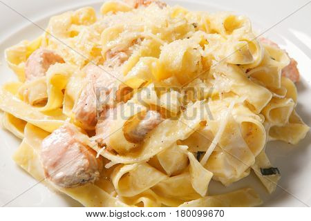 Pasta Fettuccine Alfredo With Chicken, Parmesan And Parsley On White Plate. Italian Cuisine.