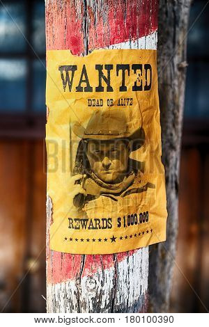 vintage wanted poster in a gost town in west usa