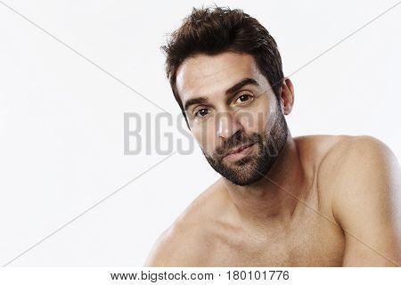 Handsome Stubble dude in white studio portrait