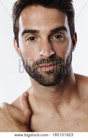 Portrait of handsome stubble guy in studio