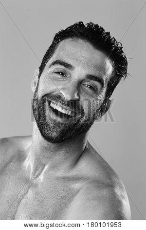 Laughing guy sweating in studio portrait studio shot