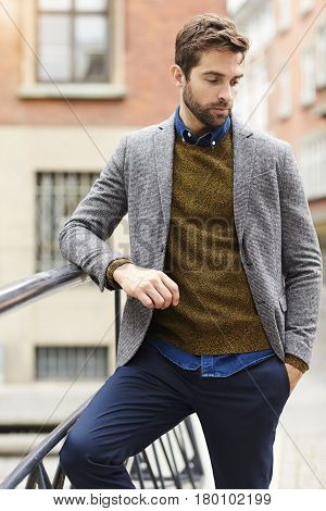 Sweater and jacket guy leaning on railing