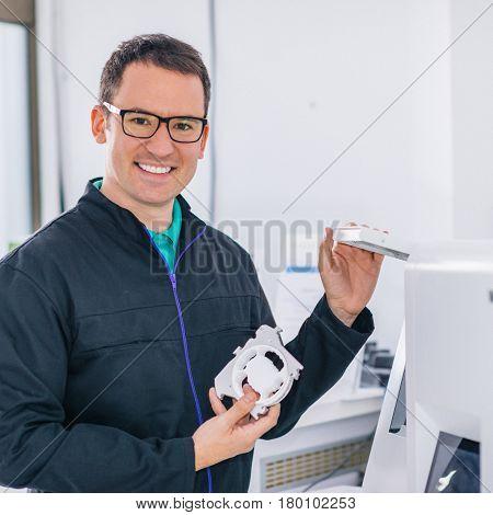 Portrait Of Dental Technician Or Dentist In His Laboratory