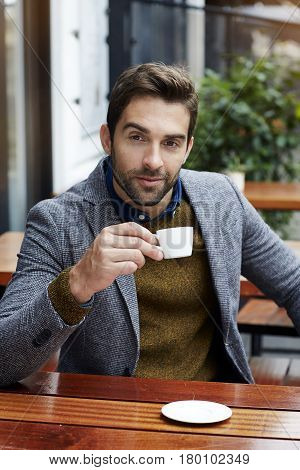 Portrait of man taking coffee break city life