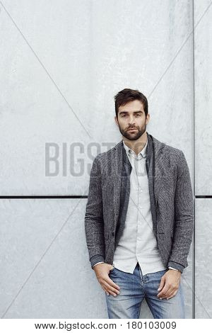 Relaxed Handsome guy in grey jacket portrait