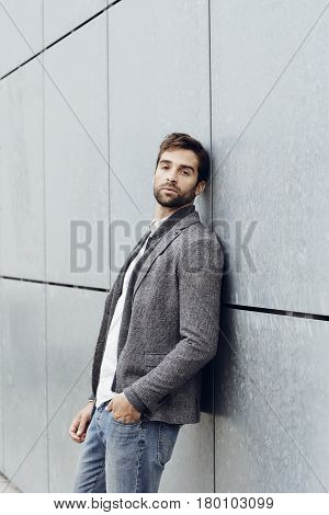 Cool Leaning guy on grey wall portrait