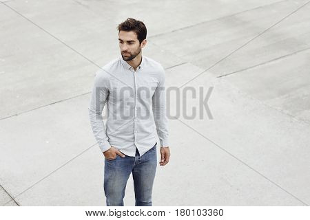 Handsome Shirt guy standing on grey pavement