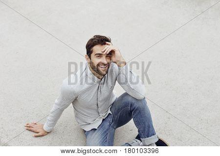 Portrait of smiling man on grey ground