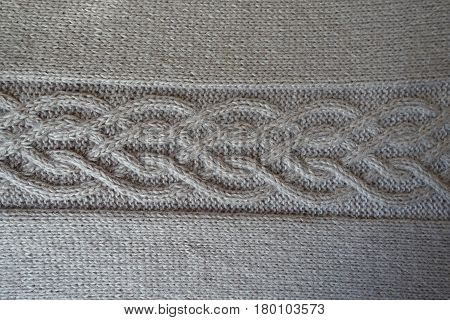 Grey handmade knit fabric with plait pattern